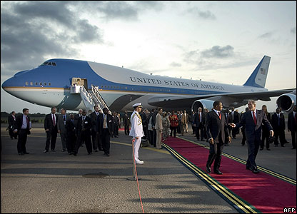 US President George Bush speaks with Tanzanian President Jakaya Kikwete as he arrived in Dar es Salaam
