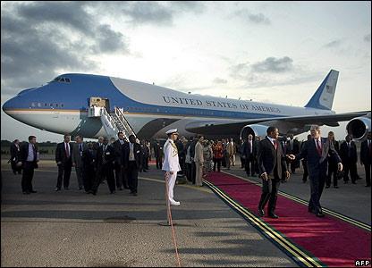 US President George Bush speaks with Tanzanian President Jakaya Kikwete as he arrived in Dar es Salaam