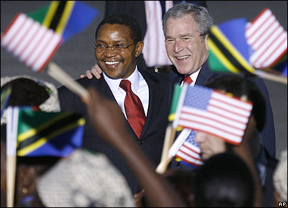 US President George Bush right is greeted by Tanzania's President Jakaya Mrisho Kikwete at Dar es Salaam airport.