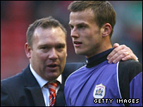 Barnsley boss Simon Davey celebrates with goalkeeper Luke Steele after his side's win at Anfield