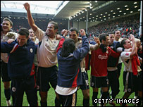 Barnsley players celebrate after their dramatic FA Cup win at Anfield