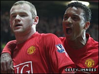 Wayne Rooney is congratulated by Nani after United's opening goal