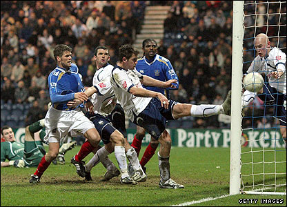 Preston's Darren Carter smashes an own goal into the roof of the net