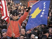 Man celebrates in Pristina with new Kosovo flag