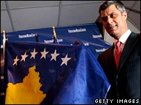 Kosovo Prime Minister Hashim Thaci with the new Kosovo flag