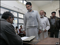 Voters cast their ballots at a polling station in Islamabad