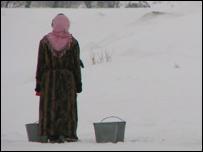 A woman stands in snow in Tajikistan (file photo)