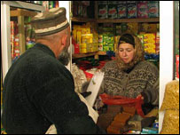 A man buys good from a shop in Tajikistan (file photo)