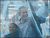 George Bush in a mosquito net at a textile mill in Arusha, Tanzania, 18 February 2008