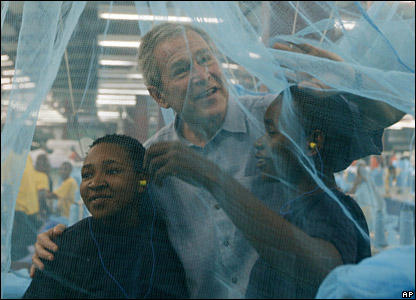 US President George W Bush and textile mill workers