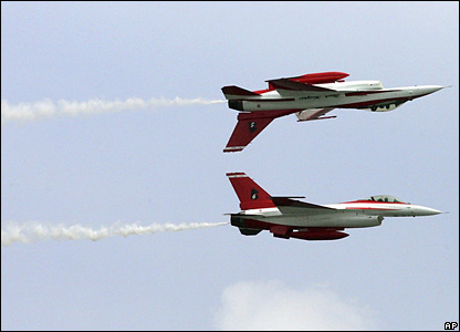 F-16 jets from the Republic of Singapore Air Force (RSAF) perform stunts