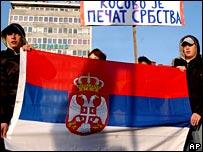 Bosnian Serbs hold a Serbian flag in Banja Luka (AP)
