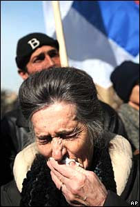 A woman cries during a pro-Serbia rally in Mitrovica, Kosovo, on Monday