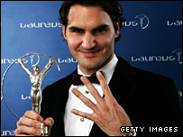 Roger Federer celebrates his fourth Laureus Sportsman of the Year award
