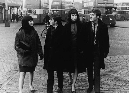 The Beatles with their fans