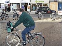 Cyclist in Kensington High St