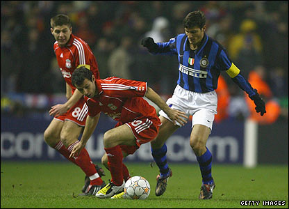 Liverpool's Javier Mascherano tussles with Inter captain Javier Zanetti