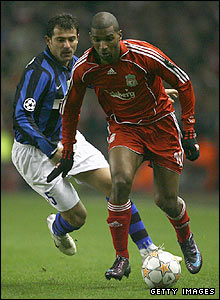 Liverpool's Ryan Babel is pursued by Dejan Stankovic