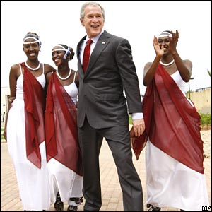 President Bush poses with dancers in Rwanda