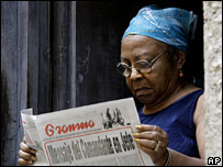 A woman reads the Granma newspaper in Havana, Cuba