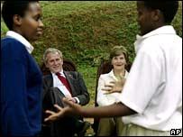 Mr Bush and Laura Bush watch children at an anti-Aids club in Kigali