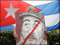 Miami Cuban carries anti-Castro poster on Tuesday