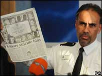 Ass Chief Cons David Morris holds up a newspaper during the briefing