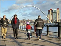 Walkers and cyclists on Newcastle's Quayside