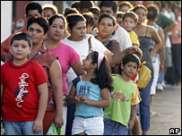 People queue to be vaccinated against yellow fever in Luque, Paraguay