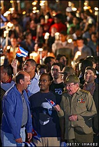 Raul Castro (bottom right) talks to Carlos Lage (left) during a march with torches on 28 January in Havana