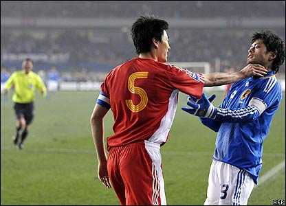Li Weifeng of China grabs Suzuki Keita of Japan by the throat after a challenge in the East Asian Football Championships in Chongqing, China.