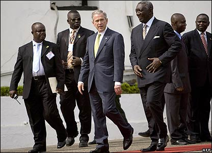 US President George W Bush (centre) and Ghana's President John Kufuor (on his right) attend an arrival ceremony for the American guest at Osu Castle, Accra