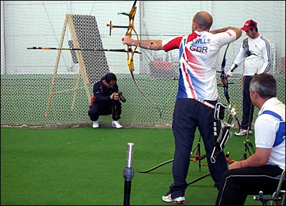 Alan Wills shooting an arrow