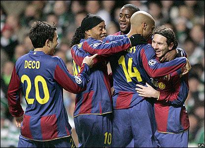 Barcelona's players mob goalscorer Lionel Messi