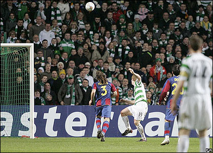 Celtic's Barry Robson sends a looping header over the stranded Victor Valdes