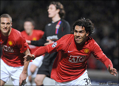 Carlos Tevez celebrates scoring the equaliser for Manchester United