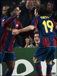 Lionel Messi (right) celebrates with Ronaldinho at Celtic Park