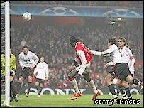 Arsenal's Emmanuel Adebayor misses a glorious late chance as he heads against the crossbar in the 0-0 draw with AC Milan
