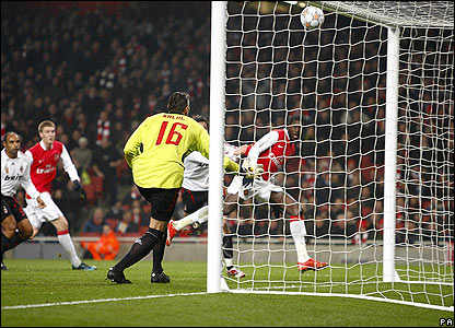 Adebayor heads the ball against the crossbar