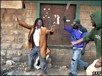 A man with a machete chases another man in Nairobi's Mathare slum on 20 February 2008