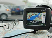 A TomTom satellite navigation system on the dashboard of a car