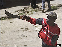 Resident of Mathare slum points his panga during clashes with police (20.02.08)