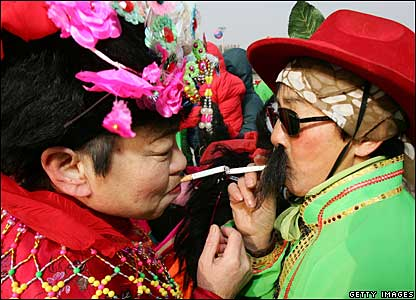Two performers take a smoking break in Changchun, 21 February 2008