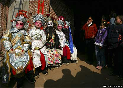 Children dressed up as historical or legendary figures wait for a performance at a village outside Xian, Shaanxi province, China, 20 February 2008