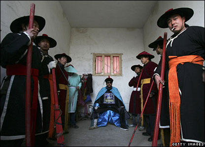Actors dressed as ancient officials at a village outside Xian, Shaanxi Province, China, 20 February 2008