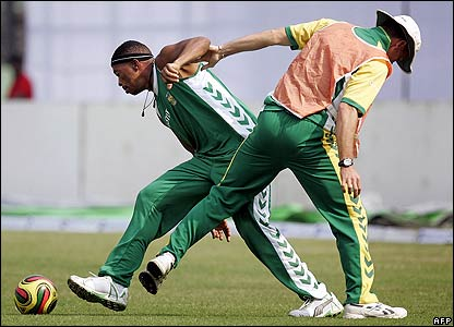 South African cricketers play a game of football during training in Bangladesh