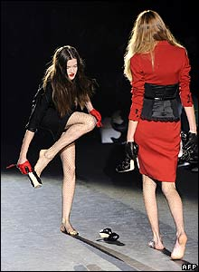 Models walk barefoot after falling during Milan Fashion Week