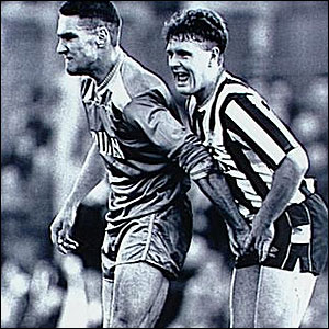 Paul Gascoigne, playing for Newcastle, is grabbed by Wimbledon's Vinnie Jones