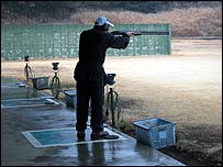 A shooter on a Japanese rifle range