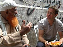 Food writer Stefan Gates talks to a mullah in Nablus